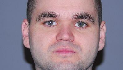 Suspended Brick Police Officer Justin A. Delaney, 33.