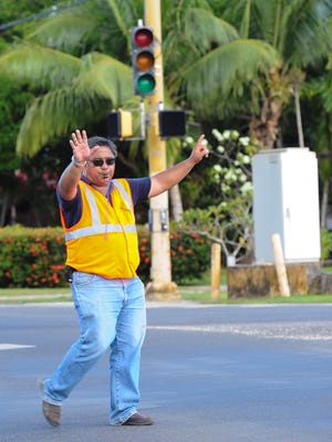 Chalan Pago-Ordot Mayor Jessy Gogue directs traffic at the Route 4 and Dero Road intersection on Tuesday, Sept. 6, due to the traffic signal being operable because of an area power outage at the time.