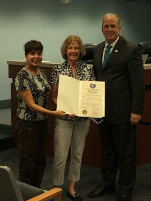 Garden Club of Stuart members Rosita Aristoff, left, and Pat Dermody accept an Arbor Day proclamation from Martin County Commissioner Ed Ciampi on Jan. 23 at the County Commission meeting, where the club's tree planting initiative was praised. A similar proclamation was presented to the club on Jan. 22 by Stuart Mayor Kelli Glass Leighton on behalf of the City of Stuart.