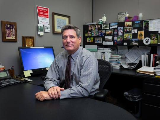 Rod Nesmith, director of the Pennsylvania Department of Environmental Protection's south central office for the Safe Drinking Water Program, poses for a portrait inside of his office at the Pennsylvania Department of Environmental Protection in Harrisburg. Nesmith oversees the water safety programs that regulate more than 100 substances in the drinking water of York and Adams county residents.
