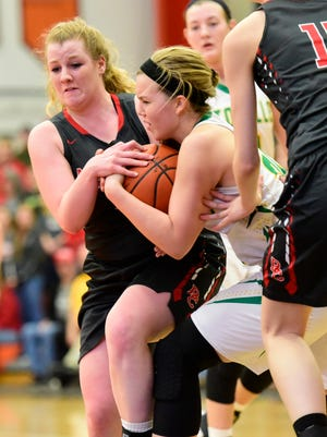 Buckeye Central's Jenna Karl, left, fights Ottoville Alexis Thorbahn during the Division IV regional semifinal in Elida.
