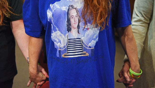 Amiee Strauser, mother of Arick Strauser, who was found beaten in a Sioux Falls driveway in July of 2016, wears a shirt with a photo of her son while talking to the media Monday, June 5, 2017, at the Minnehaha County Courthouse in Sioux Falls after Wilson Hughes, 17, entered a guilty plea to first-degree manslaughter in the death of her son.
