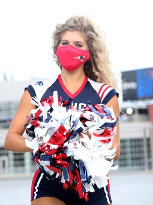 """""""We are so privileged to still be at the games, where fans can't be, and that in itself is motivating,"""" said Patriots cheerleader Kaitlyn Morris of Templeton."""
