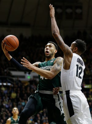 Michigan State guard Denzel Valentine (45) shoots over Purdue forward Vince Edwards (12) in the first half of an NCAA college basketball game in West Lafayette, Ind., Tuesday, Feb. 9, 2016. (AP Photo/Michael Conroy)