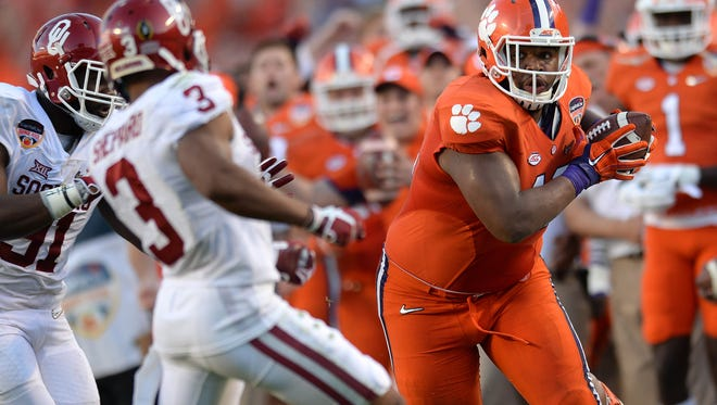 Clemson defensive lineman Christian Wilkins (42) catches a pass from Clemson punter Andy Teasdall during a fake punt in the second quarter of the 2015 Orange Bowl, December 31, 2015 at Sun Life Stadium in Miami Gardens, Fla.
