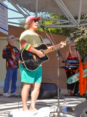 Jason Webb and the Caribbean Chillers, a Jimmy Buffett tribute band, perform on the stage at Taste of Bonita in Riverside Park on Sunday, Nov. 20.