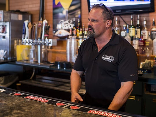 Restaurant owner Tim Metcalf explains the process of a restaurant and bar inspection at Dean-O's Pizza on Bertrand Drive in Lafayette, La., Thursday, July 16, 2015.