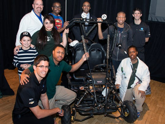 Winning TUDOR SportsCar Championship drivers Ricky (far right) and Jordan Taylor (front, far left) visited the Detroit Institute of Technology at Cody High School to meet with students over the winter.