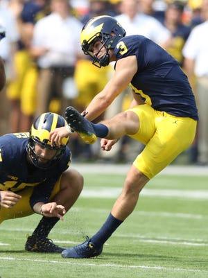 Michigan's Quinn Nordin kicks a field goal while Garrett Moores holds in the fourth quarter against Air Force, Saturday, Sept. 16, 2017 at Michigan Stadium.