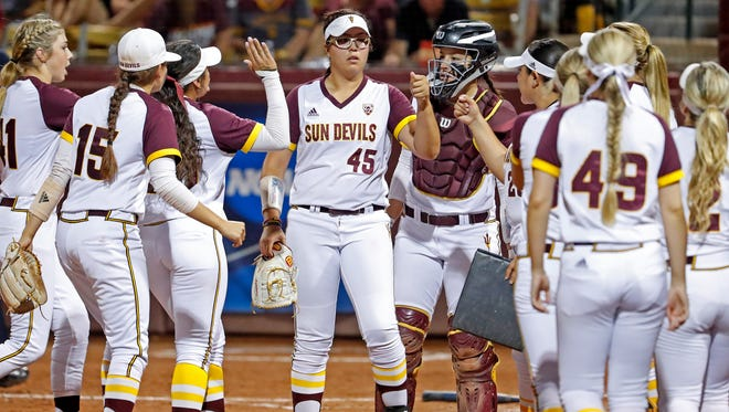 ASU's Giselle Juarez (45) is greeted by her teammates after shutting down South Carolina in the fourth inning during the NCAA Super Regional at ASU Farrington Stadium in Tempe, Ariz. on May 25, 2018.