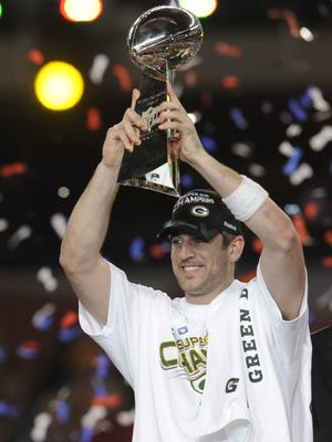 Green Bay Packers quarterback Aaron Rodgers lifts the Lombardi Trophy over his head after winning the Super Bowl against the Pittsburgh Steelers in Super Bowl XLV at Cowboys Stadium in Arlington, Texas, on Feb. 6, 2011.