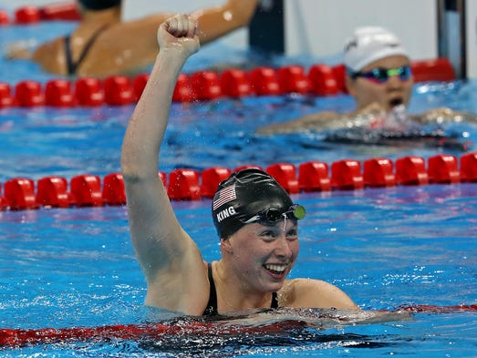 Lilly King (USA) celebrates winning during the women's