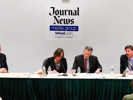 Bill Weber, left, and Michael Specht face off in a debate for Ramapo Supervisor hosted by The Journal News at SUNY Rockland Community College in Suffern on Wednesday, October 18, 2017.