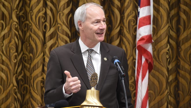 Arkansas Governor Asa Hutchinson talks about his vision for Arkansas during a Mountain Home Rotary lunch meeting Thursday. Hutchinson spent the latter half of his time pitching his plan to revamp Arkansas' private option.