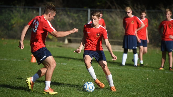 The Seton Catholic High School boys soccer team practices Tuesday, Oct. 11, 2016 at Freeman Park in Richmond in preparation for the regional tournament.