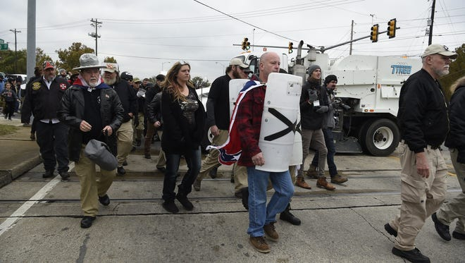 Protesters march down the street to get into security for the White Lives Matter rally in Shelbyville, Tenn., on Saturday, Oct. 28, 2017.