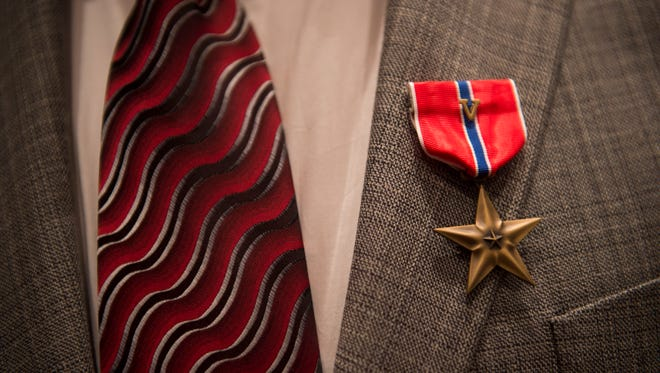 """Army Specialist Four Andrew Thorry, 70, of Vero Beach, earned a Bronze Star with """"V"""" Device for helping a squad from another platoon by continuously exposing himself to enemy fire to gather men and laying down a base of fire to help the troubled American troops reach safety while serving in Vietnam as a radio telephone operator on Feb. 8, 1968."""