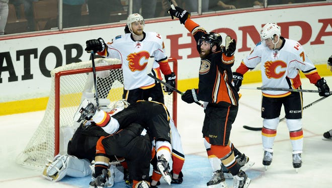 Anaheim Ducks left wing Patrick Maroon (19) celebrates after Anaheim Ducks right wing Corey Perry (10) scores the game winning goal.