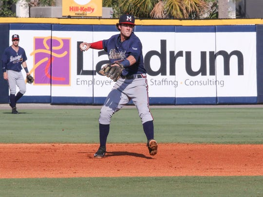Mississippi's Dansby Swanson throws the ball to first base Sunday afternoon at Blue Wahoos Stadium.