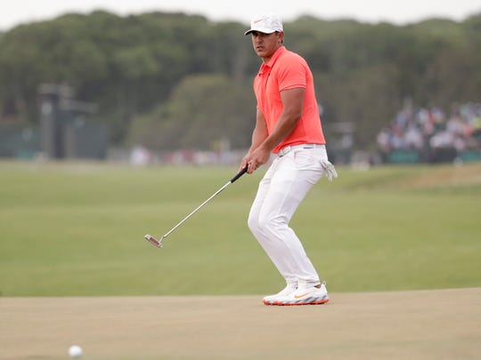 Brooks Koepka misses a putt on the 16th hole during the third round of the U.S. Open Golf Championship, Saturday, June 16, 2018, in Southampton, N.Y. (AP Photo/Julio Cortez)