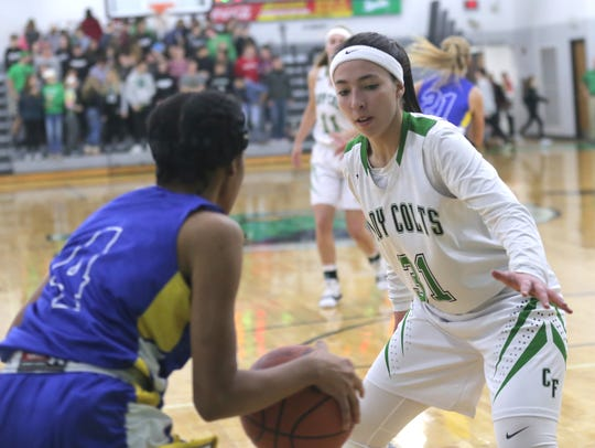 Clear Fork's Macy Wade guard Ontario's A'Sharion Houston
