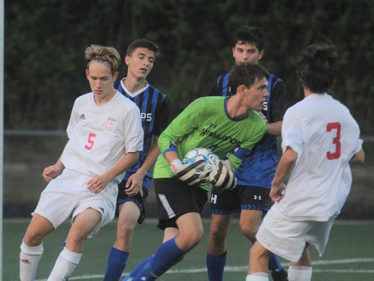 Highlands senior keeper Will Burnham grabs the ball in traffic during Highlands' 3-1 win over St. Henry in boys soccer August 30, 2018 at Tower Park, Fort Thomas.