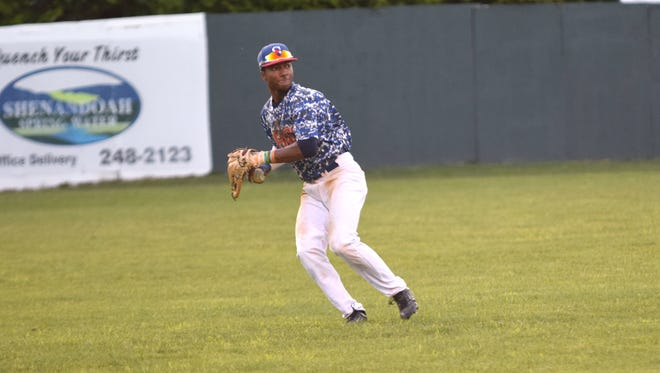Staunton Braves left fielder Jay Charleston makes a throw to home plate during a Valley Baseball League game against the Front Royal Cardinals on Wednesday, June 28, 2017, at John Moxie Memorial Stadium in Staunton, Va.