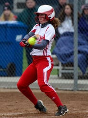 Port Clinton's Taylor Steyer bangs out a base hit.