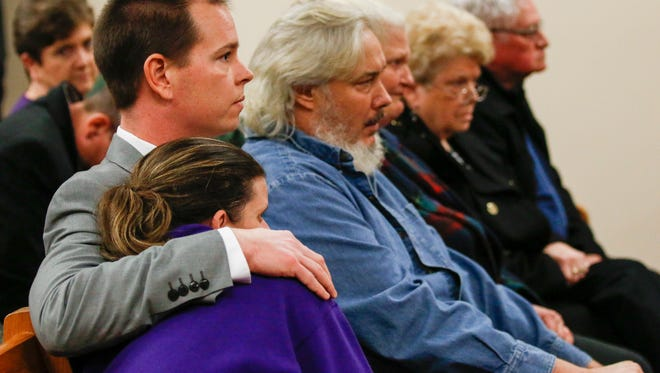 Stacey Herman, the mother of Hailey Owens, is hugged by detective Neal McAmis after Craig Wood was sentenced to death for the abduction and murder of her daughter Hailey Owens in 2014.