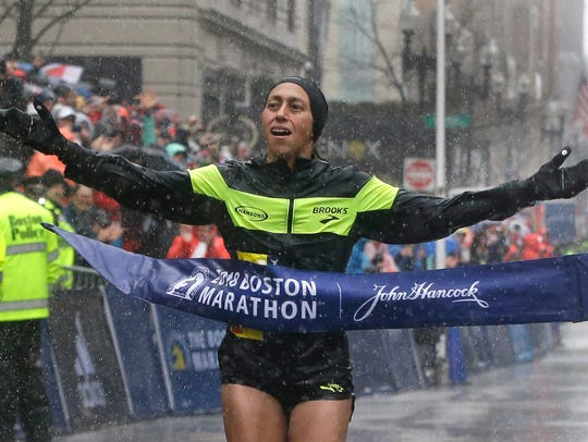 Desiree Linden, of Washington, Mich., crosses the finish