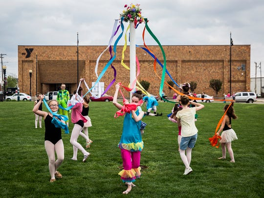 Maypole dancers perform in Canan Commons at the May 2018 First Thursday.