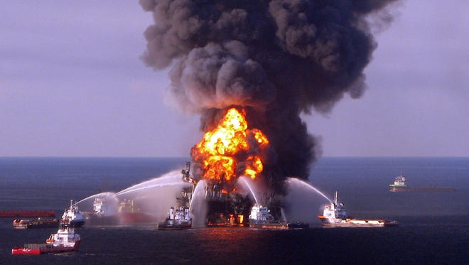 A file photo taken on on April 21, 2010 shows a U.S. Coast Guard image of fire boat response crews as they battle the blazing remnants of the BP operated off shore oil rig, Deepwater Horizon, in the Gulf of Mexico.