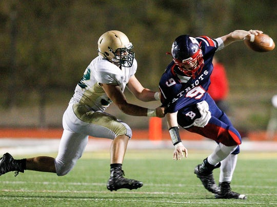 Vestal's Todd Degroat sacks Binghamton's Daniel Crowley in the second quarter at Binghamton Alumni Stadium on Friday, October 13, 2017.