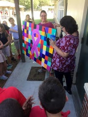 Students at Rosewood Magnet Elementary created this artwork to show their support for their beloved fifth-grade math and science teacher.