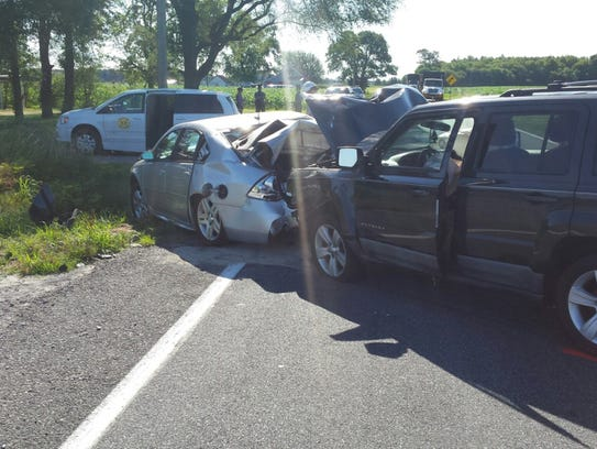 Three vehicles, including a prison van, collided west