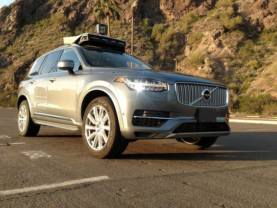 A handout photo from Uber shows one of its Volvo self-driving