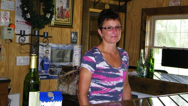 Sherrie Walters stands inside Winesteins Wine and Beer Haus on the grounds of Lazy River Campground. She and her late husband Eric purchased the campground in 2004 and built the bar four years ago.