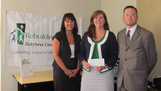 Diana Stile, left to right, Christina Boryk and CJ Tomaskovich attended the check presentation for Rebuilding Together Dutchess County
