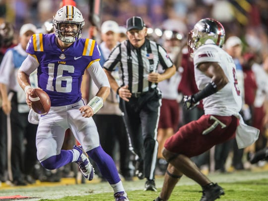 LSU Tigers quarterback Danny Etling (16) gets to the outside with the keeper during a non-conference game against Troy on Saturday Sept. 30, 2017.