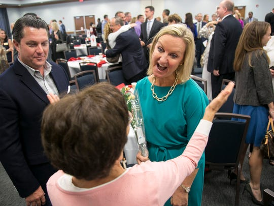 Christin Collins is congratulated Tania Matos after winning The News-Press Person of the Year on Tuesday, February 21, 2017, at FGCU.
