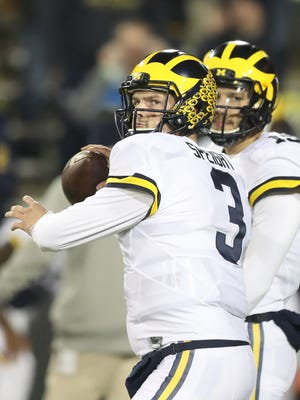 Michigan QB Wilton Speight warms up before action against Iowa Saturday in Iowa City, Iowa.