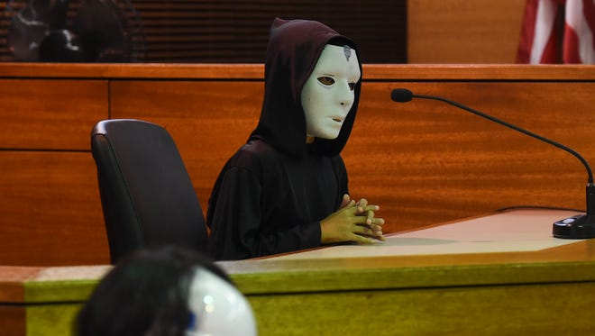"""Emperor Palpatine, played by Zander Barcinas, 10, takes the witness stand during a mock trial of """"The People v. Luke Skywalker"""" at the Superior Court of Guam in Hagåtna in this April 30, 2018, file photo."""