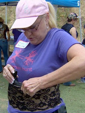A woman with a concealed handgun license learns about female-friendly ways to carry a weapon, in this case with a corset holster.