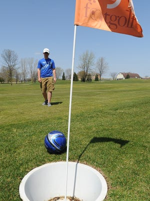 Austin Cutter, of Fond du Lac, watches the ball he kicked as it travels towards the Hole No. 9 at Rolling Meadows Golf Course Saturday.