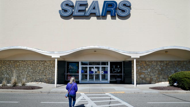 A shopper walks up to a Sears department store at the Tri-County Mall, in Springdale, Ohio, in this March 22, 2017 photo. Sears will no longer sell Whirlpool appliances, ending a business partnership that dates make more than 100 years.