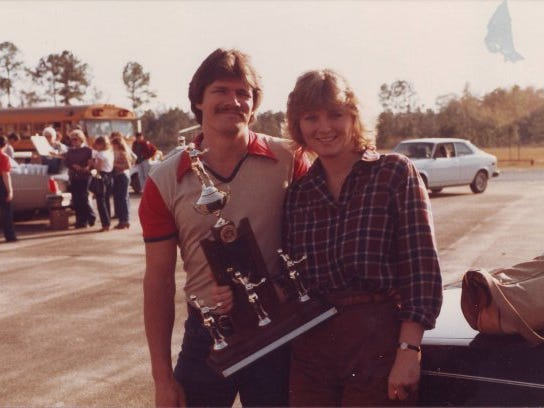 Susie Morris, with husband Kirby, after winning a district title early in her coaching career at Munroe.