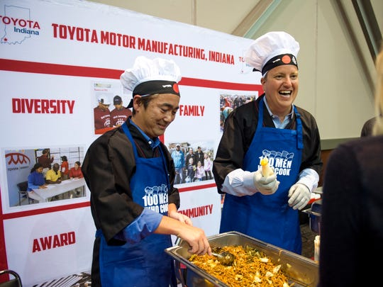 Tim Hollander, right, and Ted Kawajiri, serve Yakisoba at the 100 Men Who Cook fundraiser at the Old National Events Plaza on August 26, 2017. The event is Old National Bank's signature fundraiser, and this year raised money for Vanderburgh County CASA. Organizers expected over 800 attendees.