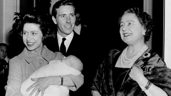 Princess Margaret (L), holding her newborn son, David Viscount Linley, leaves with husband Antony Armstrong-Jones Lord Snowdon (C), and Margaret's mother, the Queen Mother, on Dec.1, 1961 at Clarence House.
