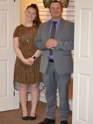 Annabelle McCombs has been job-shadowing Josh Fleming, funeral director at Lighthouse Funeral & Cremation, for the past year. He gives her high marks for her interest and progress.