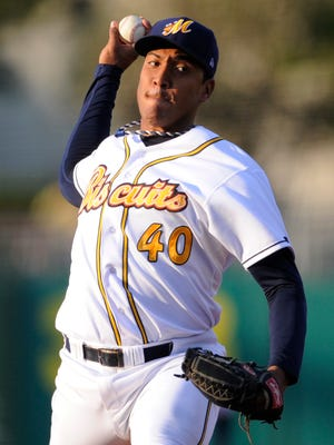 Montgomery Biscuits pitcher Albert Suarez throws against the Mississippi Braves at Riverwalk Stadium in Montgomery, Ala. on Saturday July 5, 2014.